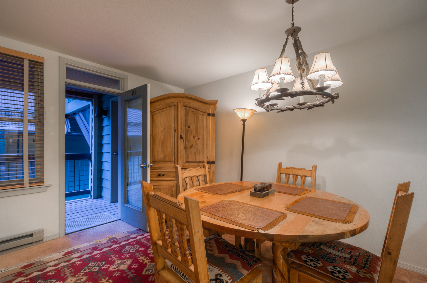Dining Area with Access to the Balcony, Dining Table, Chairs, and Armoire