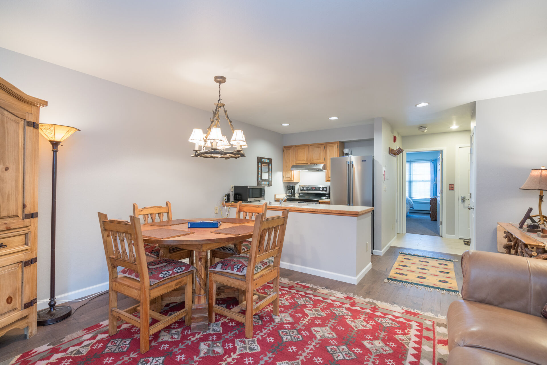 Dining Table, Chairs, Kitchen with Refrigerator, Microwave and Coffee Maker