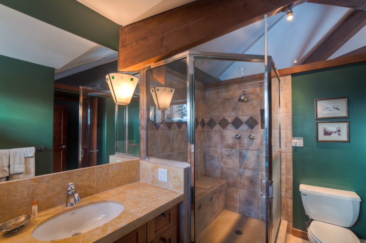 Master bedroom with a steam shower