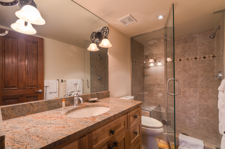 Bathroom with a walk in shower and a sink