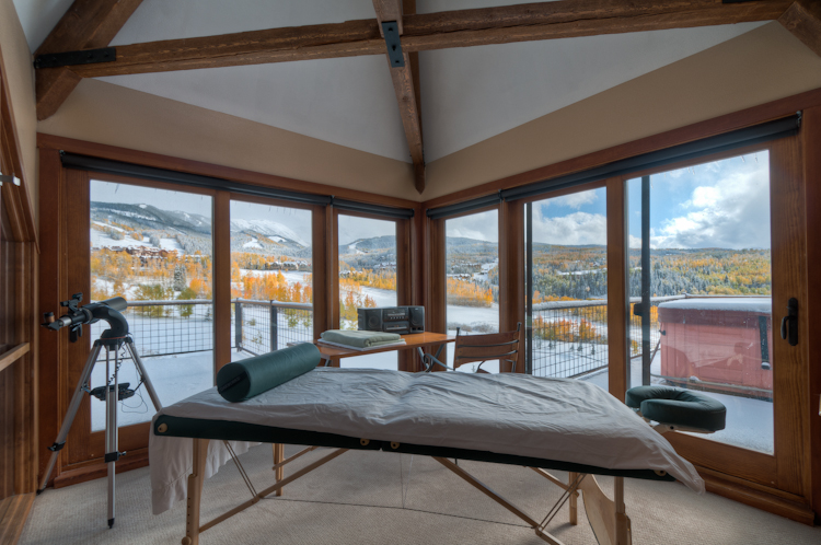 Massage room with a massage table and a telescope