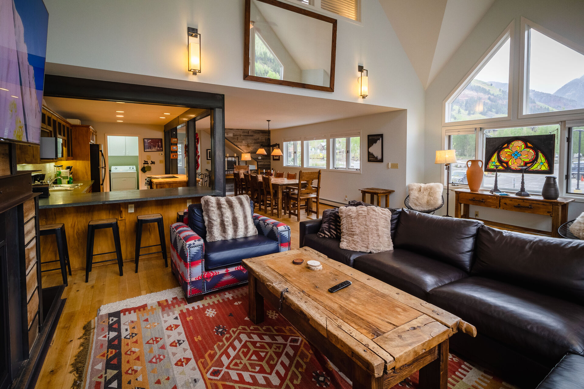 Living area with views into Kitchen and Dining area