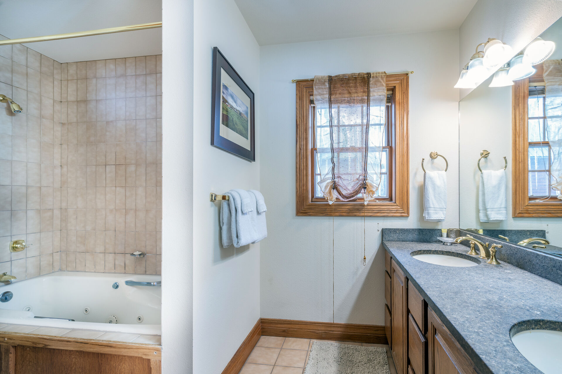 Bathroom with two sinks and a tub