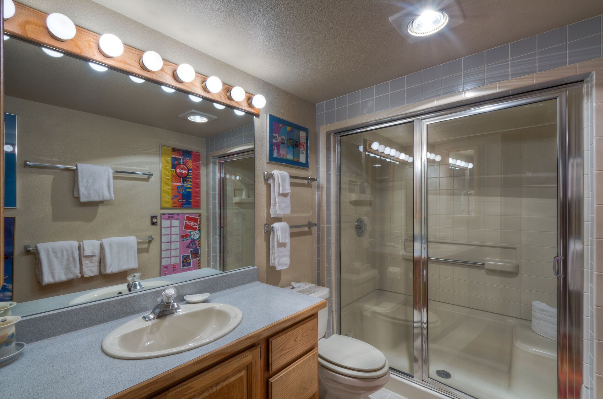 A walk in shower, a toilet and a sink