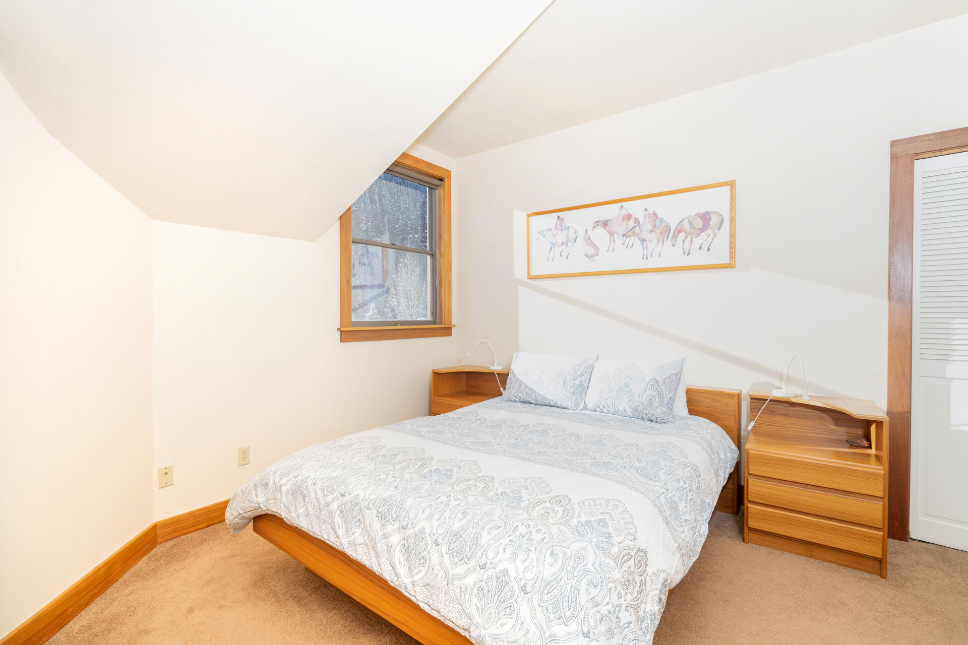 Second bedroom with a bed and a nightstand