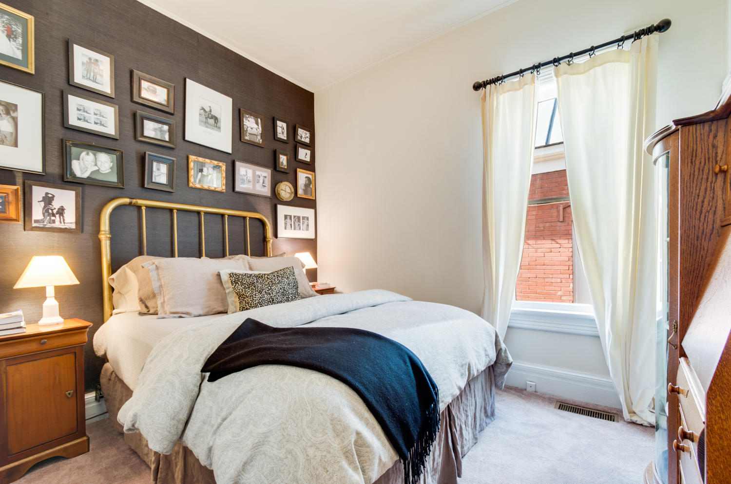 Master bedroom with a bed and a nightstand