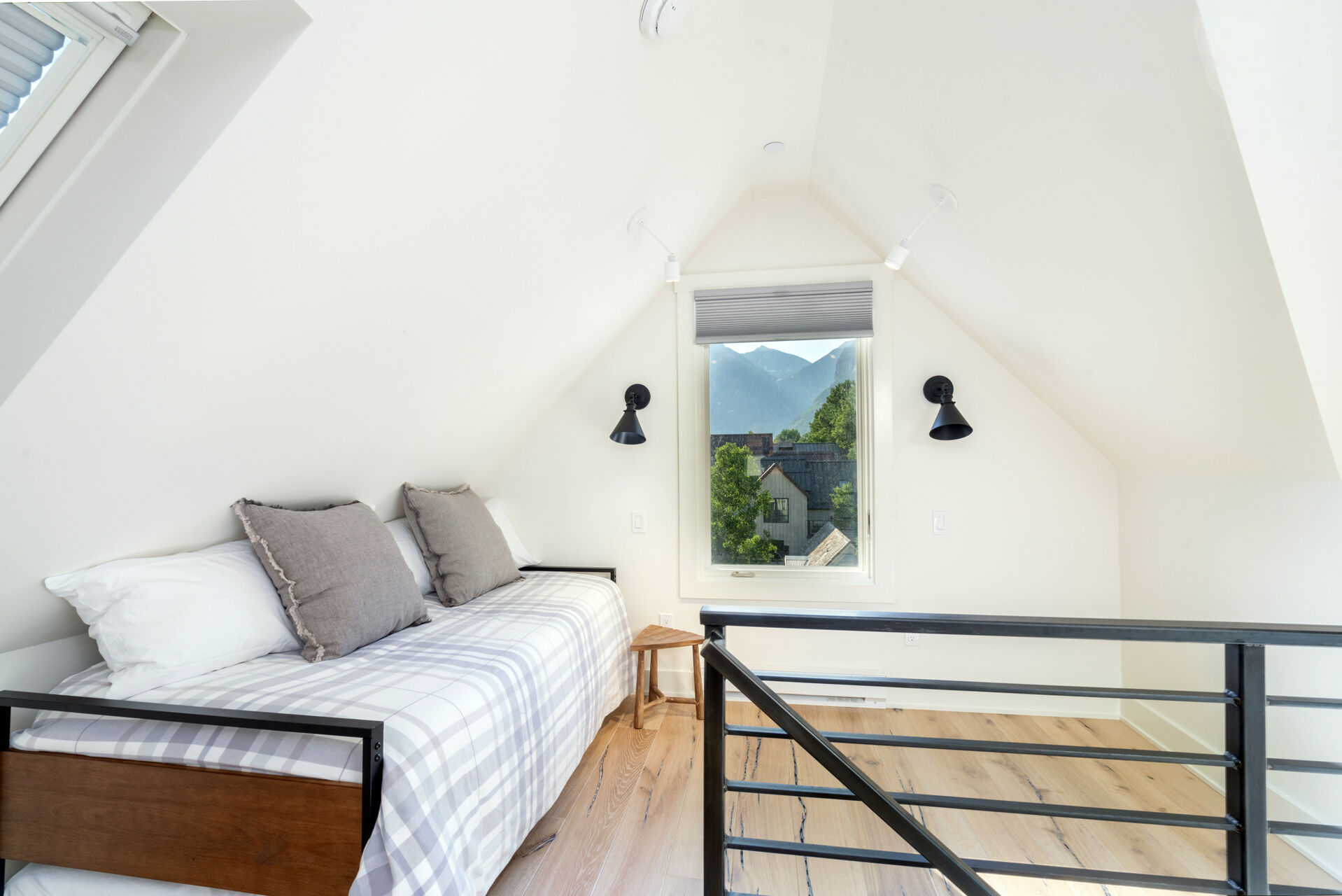 Loft area with a bed