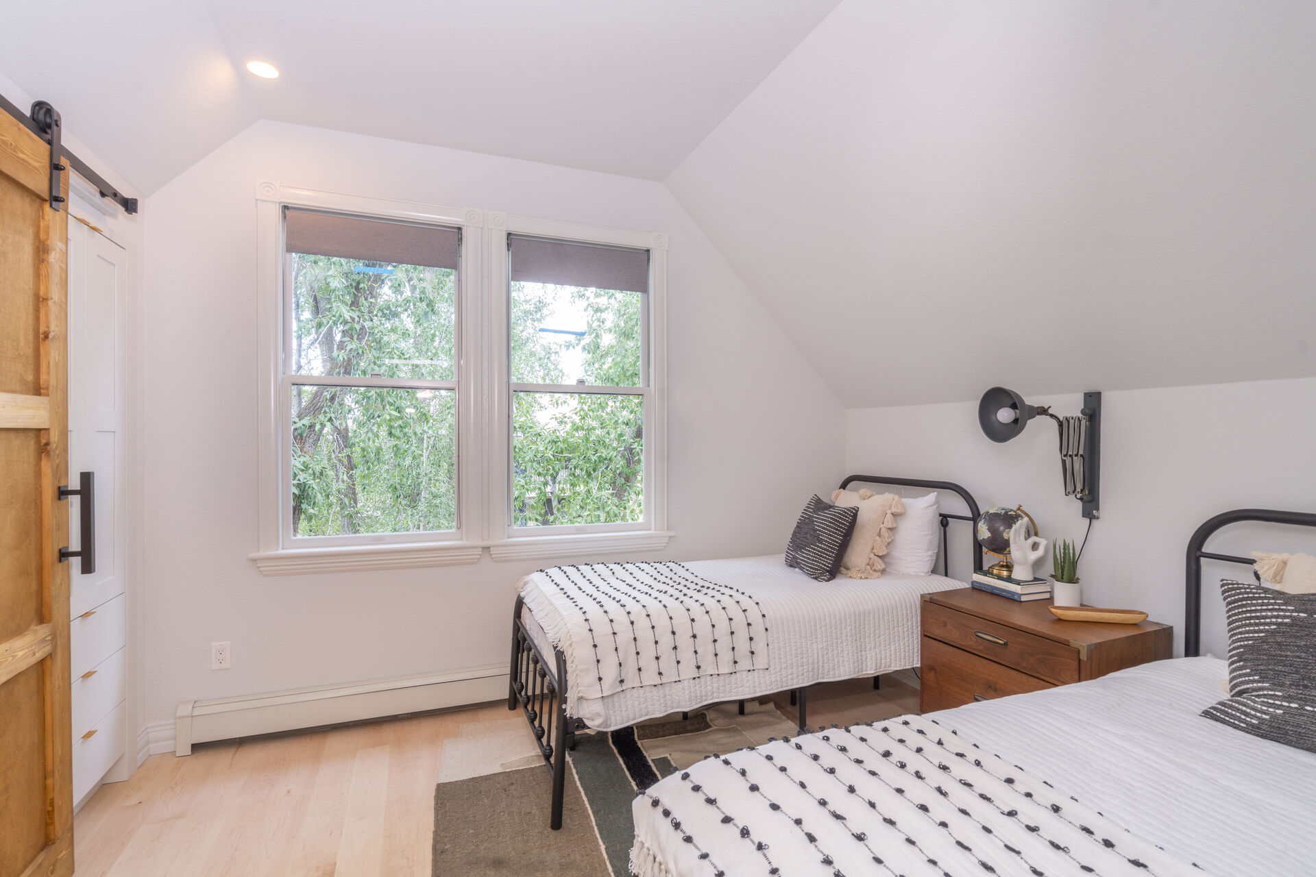 Bedroom with two beds and a nightstand