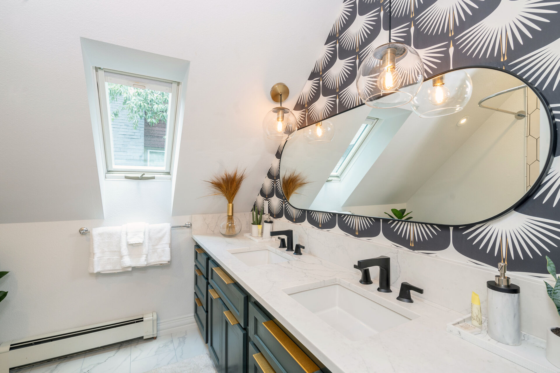 bathroom with two sinks and a long mirror