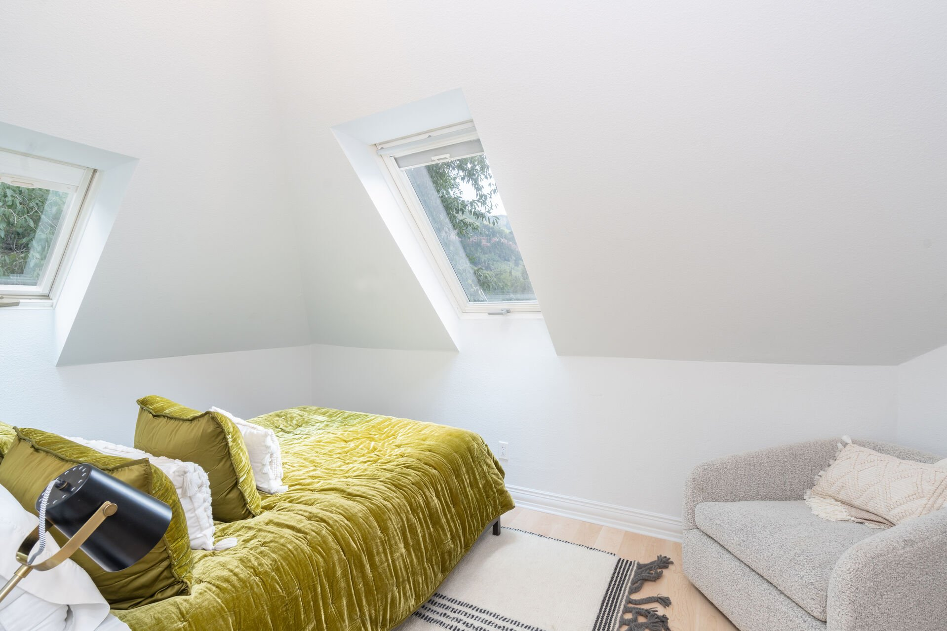Upstairs bedroom with skylights.