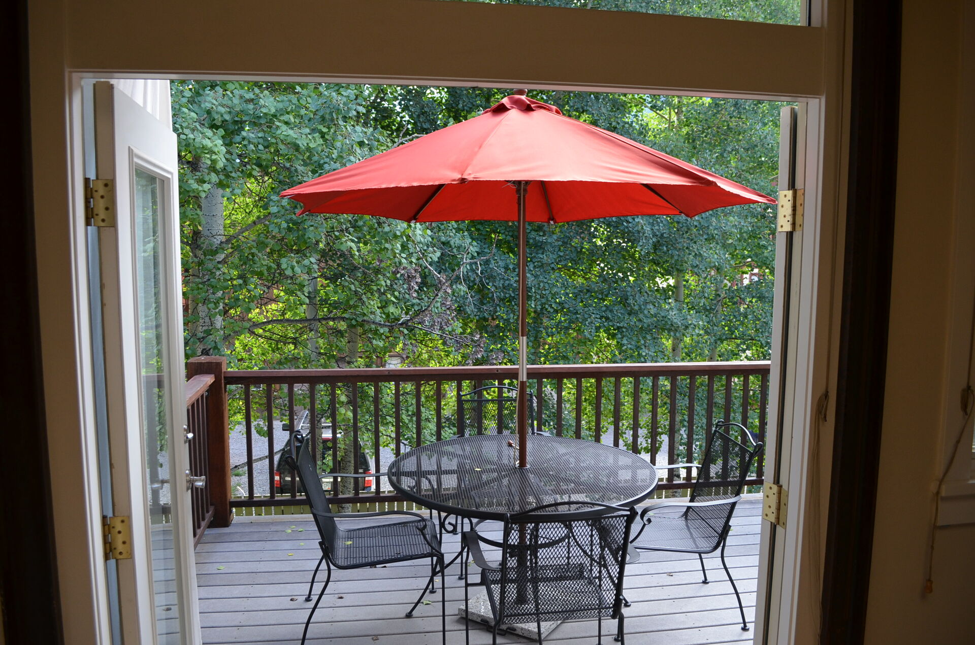 Deck with a table and seating for 3
