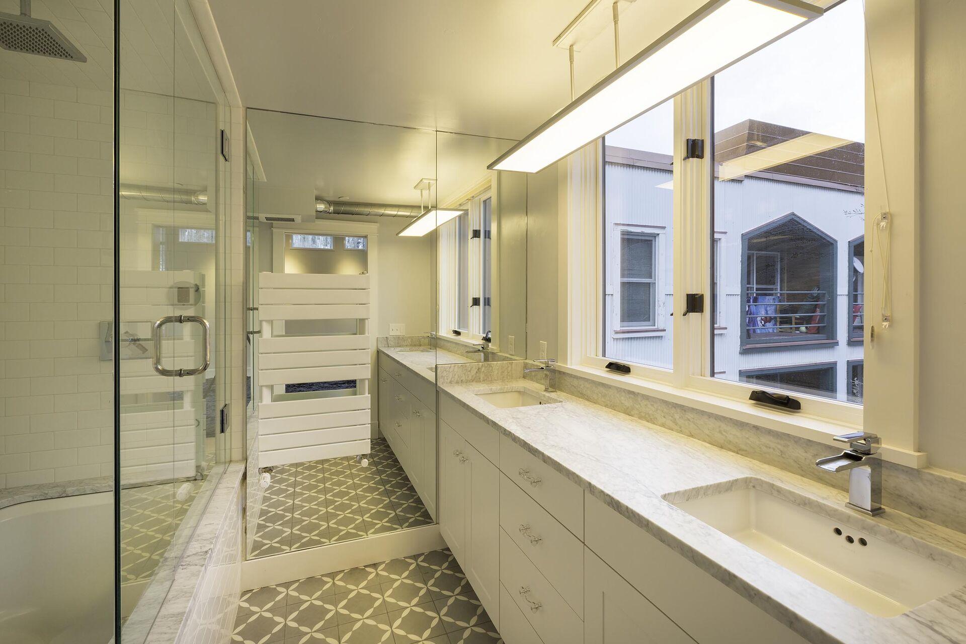a spacious bathroom with sinks