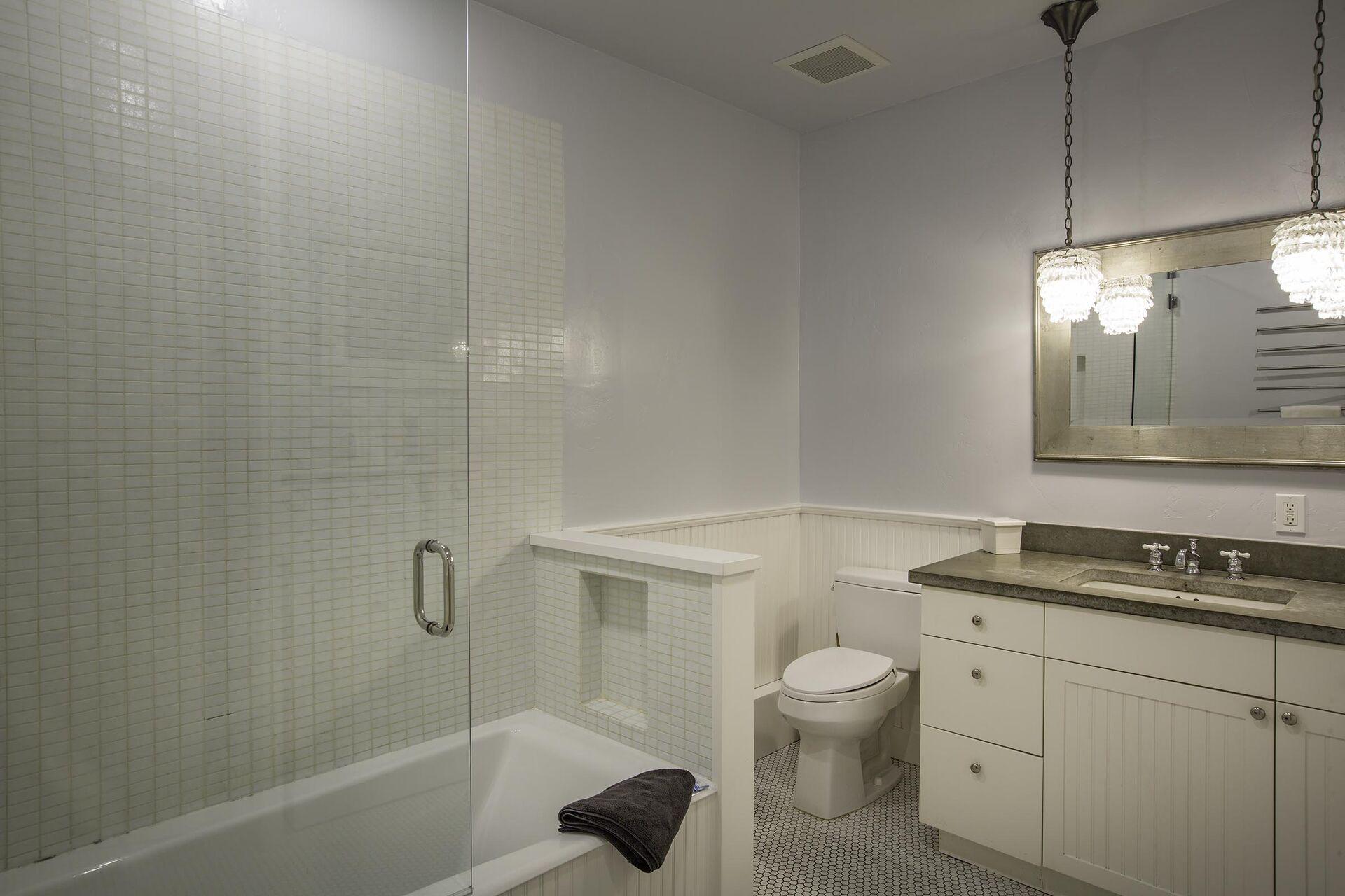 A bath tub, a toilet and a sink