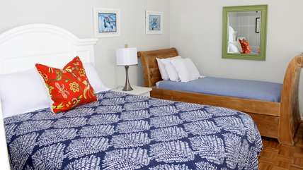 The 1st floor bedroom sleeps 3 in the queen and a twin bed with a trundle.