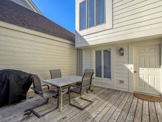 The deck has a table great for dining and a gas grill for barbecuing.