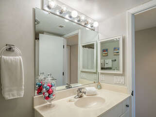 The guest bathroom is accessible from the hall.