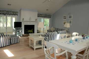 The cathedral ceilings, hardwood floors and open space invite you to relax.