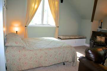 It also serves as the 4th bedroom and has a queen bed.