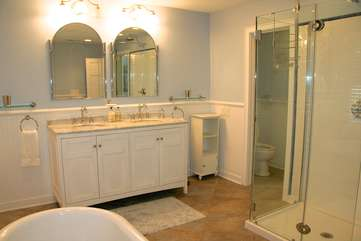 It has a vanity with two sinks, separate toilet room and a fabulous shower.