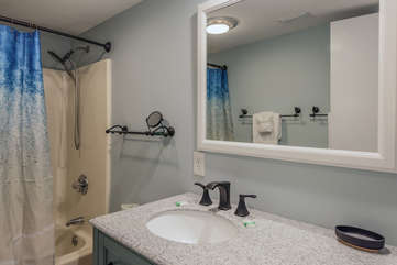en suite bathroom has tub/shower combination.