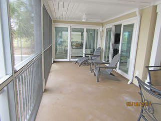 Large screened in porch to relax at the end of the day.