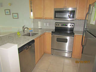 New countertops, backsplash and appliances in this remodeled villa!