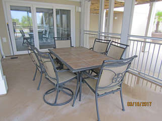 Large screened in porch with table and seating!