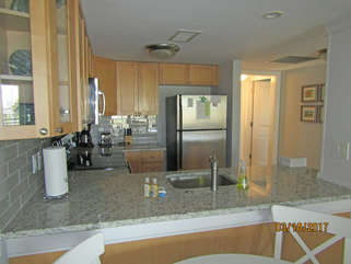 Open kitchen to the living area to enjoy each others company while preparing meals.