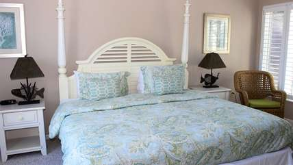 The master bedroom has a king bed and is bright and cheery.