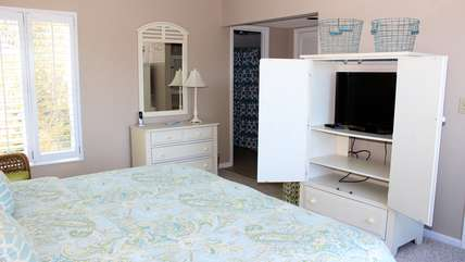 The armoire has an HDTV for viewing. The suite also has a private bathroom.