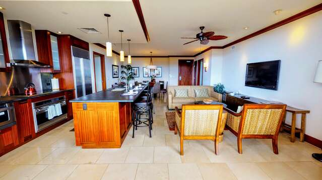 View Inside the rental From the Lanai, with the living area and kitchen in shot.