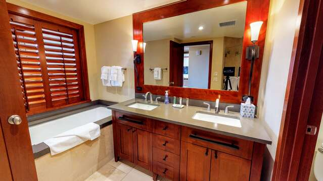 Master Bathroom with vanity sink and large tub.