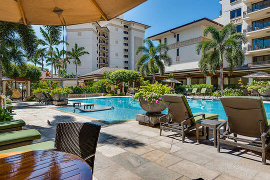 The Quiet Pool, with tables and poolside chairs, located by this Ko Olina beach villa for rent.