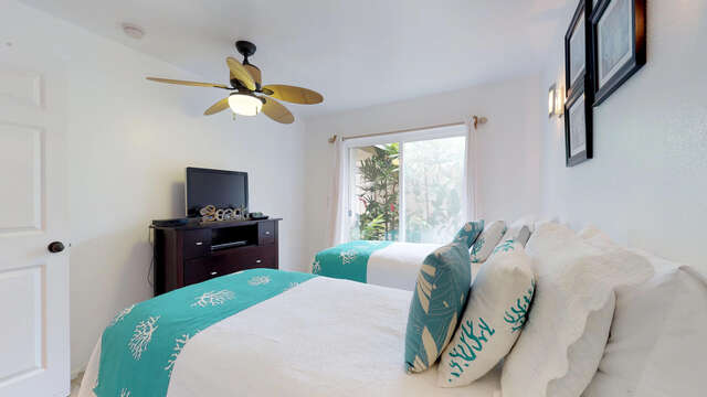 The Second Bedroom has Access to a Private Lanai, a Flat Screen TV and Ceiling Fan