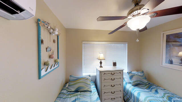 Third Bedroom Has Two Twin Beds and Large Dresser.