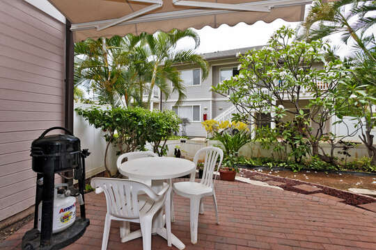 Enjoy Seating on the Lanai with Barbecue Grill and Table.