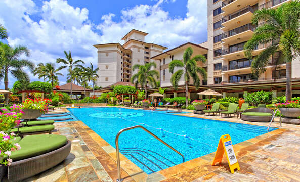 The Lap Pool with Poolside Lounge Chairs, and Table Umbrellas.