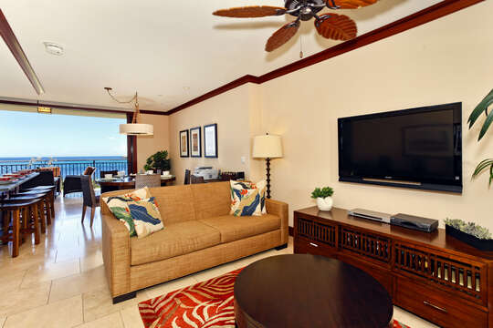 Living Area with TV, Sofa, Coffee Table, Ceiling Fan, and Views of the Ocean.