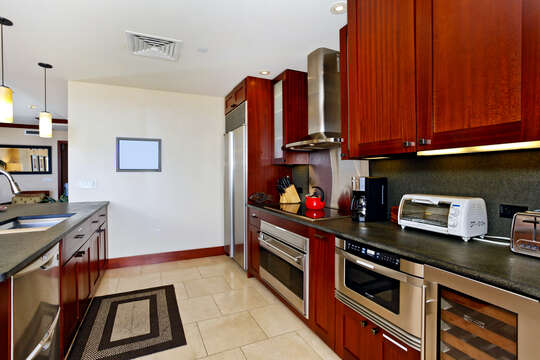 Kitchen with Island, Refrigerator, Stove, Oven, Coffee Maker, Wine Cooler, and Dishwasher.