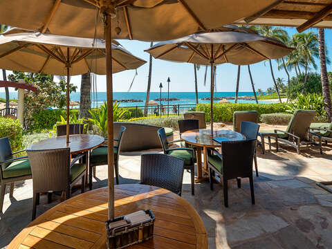 Outdoor Dining Tables, Table Umbrellas at the Beachfront Bar with Ocean View.