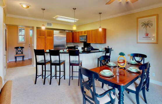 Dining Table, Chairs, Kitchen with Bar, High Chairs, Refrigerator, and Microwave.