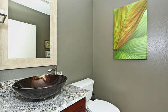 Half Bath with Beautiful Sink and Mirror Above.