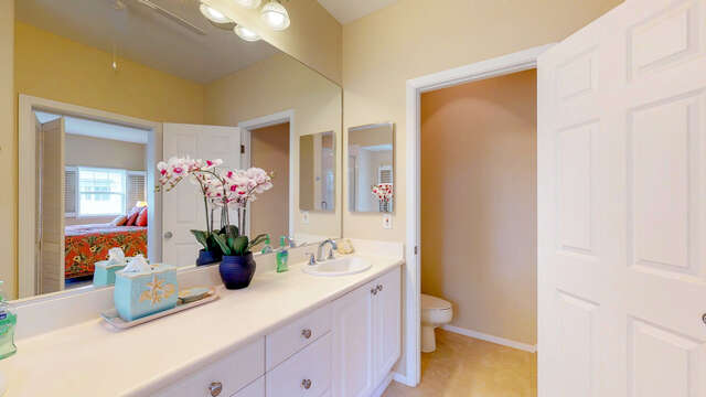 Master Bath with Dual Sinks and Large Mirror.