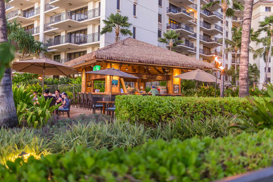 Private Beach Bar with Stools and Outdoor Dining Tables Sets with Table Umbrellas.
