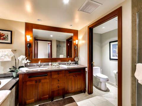 Bathroom with Double Vanity Sink, Toilet, Shower, Bathtub, and Mirror.