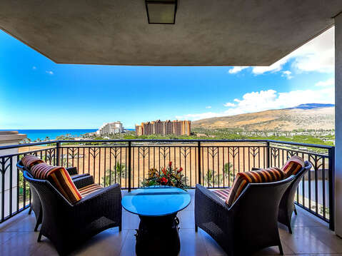 Views of the Ocean and Mountain from the Balcony with Outdoor Seating Set.