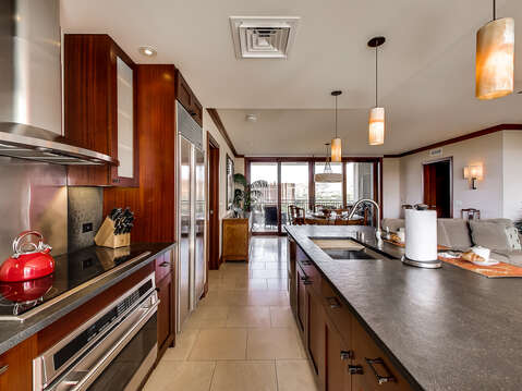 Kitchen with Bar, Oven, Refrigerator, Ceiling Lamps, and Dining Set.
