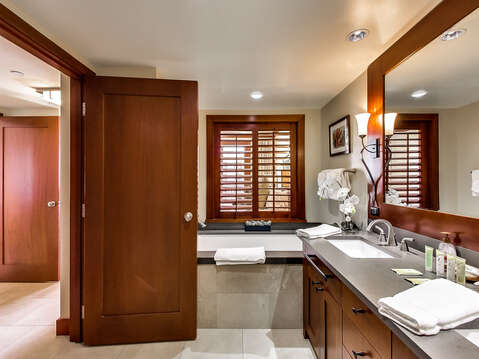 Double Vanity Sink,  Large Soaking Tub, and Mirror.
