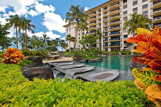 Water Loungers in a Tropical Setting with View of Beach Villas at Ko Olina
