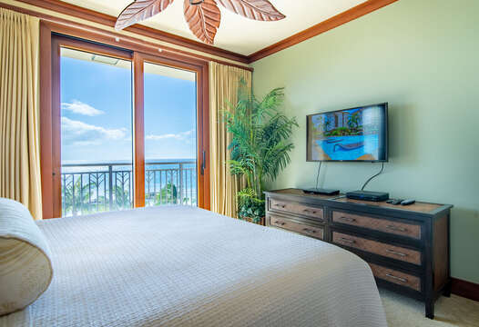Access to Lanai From Bedroom with Flat Screen TV inside our Ko Olina Condo Rental